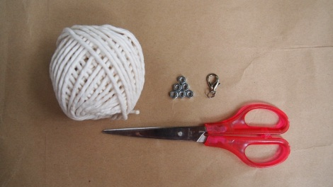 You'll need: Cotton Twine, Hex Nut, Hook with Ring, Scissors.