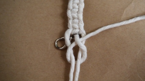 11. Make a loop with the middle string & tie a know with all three strands at the end.