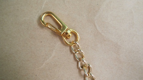1. Measure desired wrist length for the chain. Link the chain & hook together using the pliers.