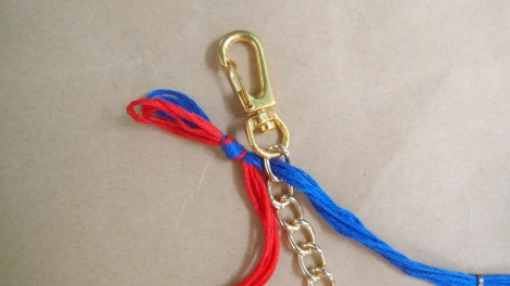 3. Starting from the first chain, loop the blue threads through from underneath the chain.